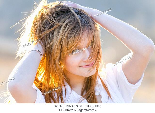 Happy with a messy hair young woman portrait