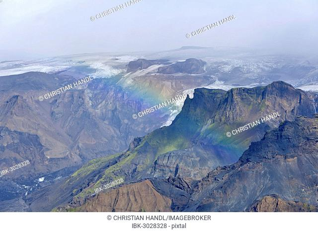 Gorges of Thorsmörk below the Myrdalsjökull glacier with a rainbow, on the long-distance hiking trail from Skógar via Fimmvörðuhals to the Thórsmörk mountain...