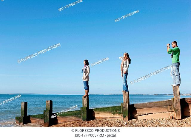 People looking out to sea