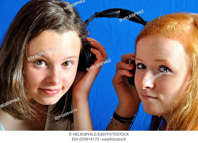 Two teen listening to music