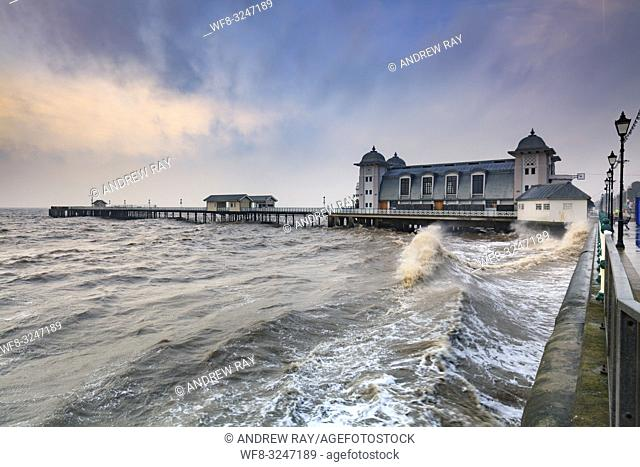 The Victorian Pier at Penarth near Cardiff in South Wales, captured at sunrise from the promenade on a stormy morning in mid February