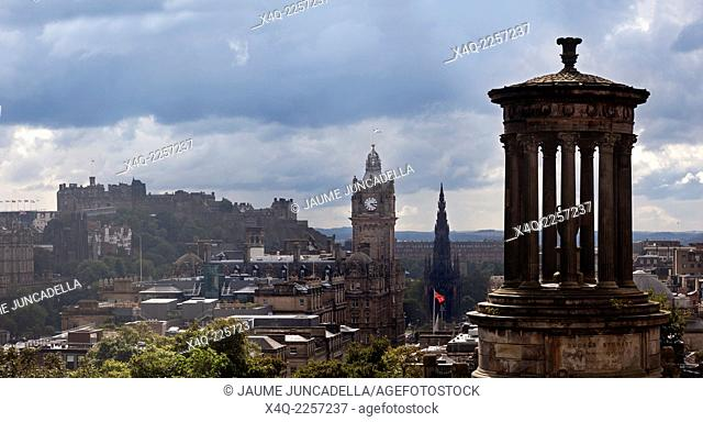 Edinburgh, Scotland. After the rain, when the clouds break, the city lights up with the sunshine, showing a view from Calton Hill towards Edinburgh Castle and...