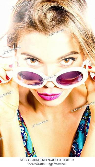 Closeup fashion portrait of young pretty woman in summer day sunglasses pouting in glamorous style. Vogue pin up