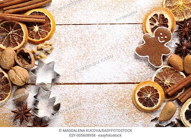 Top view of wooden board with Christmas baking ingredients