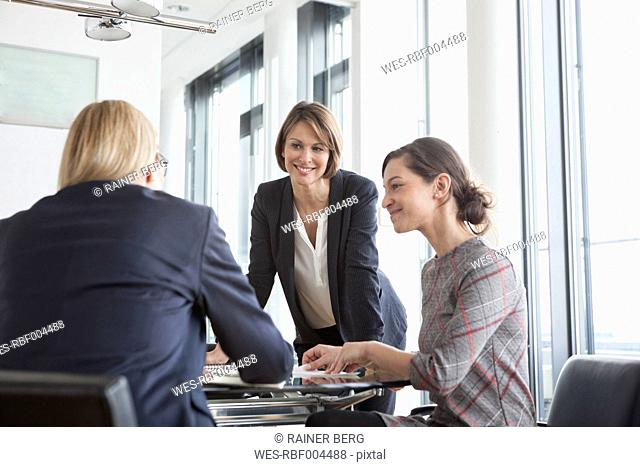 Three businesswomen having a meeting