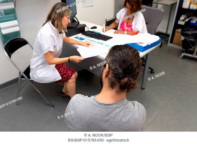 Care for deaf patients in sign language, Nice Hospital, France. Consultation with a patient who is under 40 and deaf, suffering from Usher syndrome