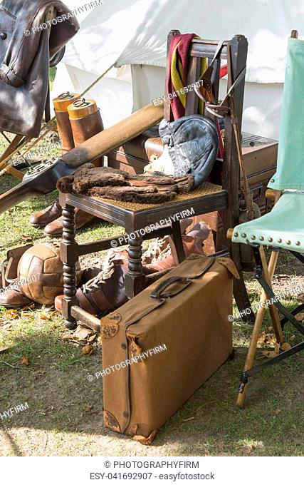 Vintage suitcase, football, shoes, and other antiquities