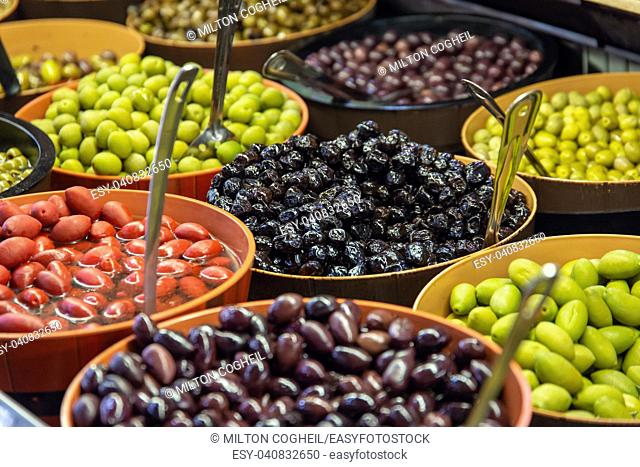 Bowls of green and black olives on display on a stall in St Lawrence Market, Toronto, Canada