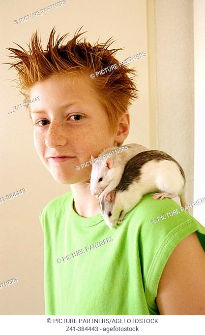 Pre-teenager and two rats