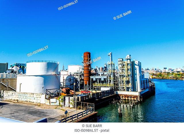 Elevated view of industrial biofuel plant on river waterfront