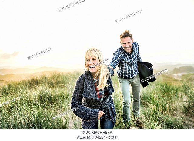 Happy couple in dunes