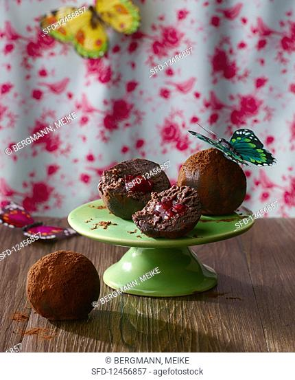 Chocolate balls with a cherry filling