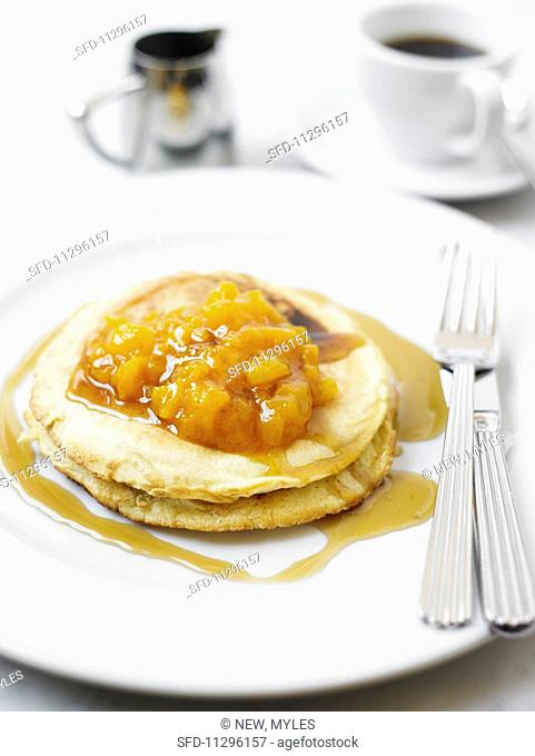 Pancakes with apricot compote and maple syrup