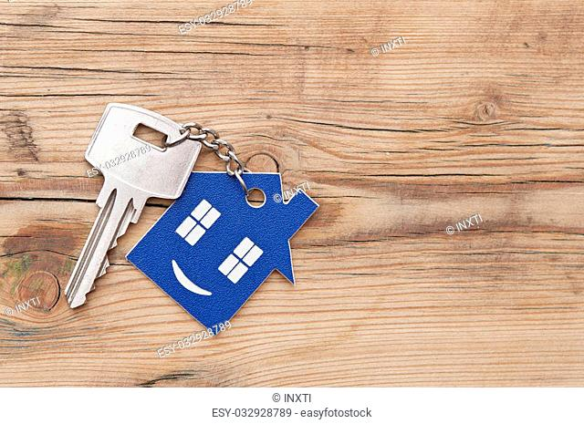 Keychain figure of house and key close up