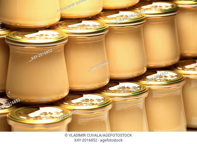 Studio shot of jars of set multifloral honey