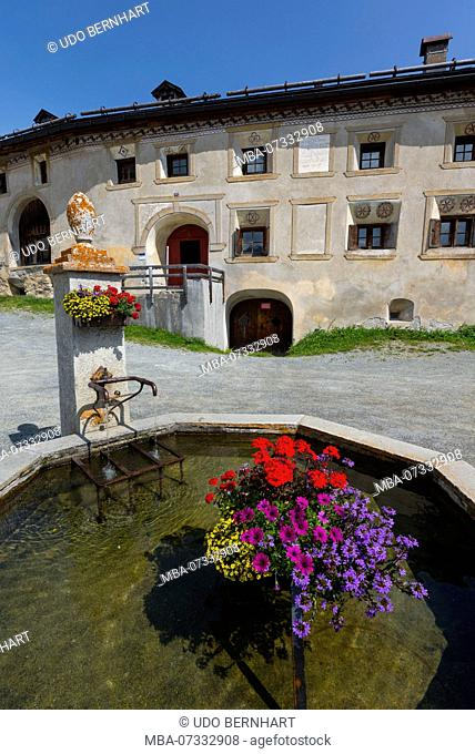 Townscape with fountain and typical house, Guarda, municipality Scuol, Lower Engadine, Grisons, Switzerland