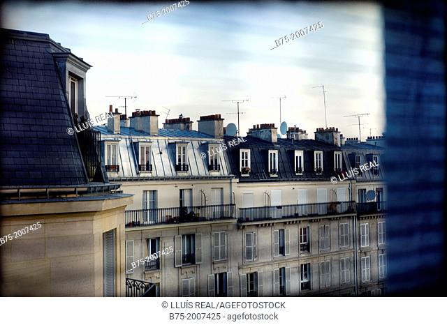 View from a window of apartments and garrets of a typical neighborhood of Paris, France Europe