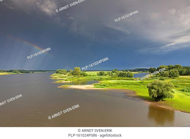 Rainbow over the UNESCO Elbe River Landscape biosphere reserve in summer, Lower Saxony, Germany