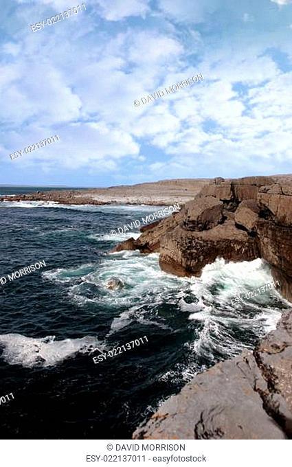 wave crashing on cliffs