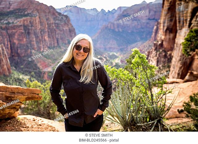 Caucasian woman posing near rock formations