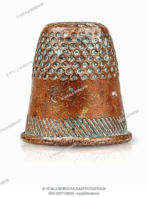 Old antique copper thimble isolated on white background