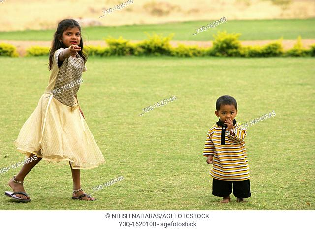 Young boy and sister in Hampi, a world heritage site in India