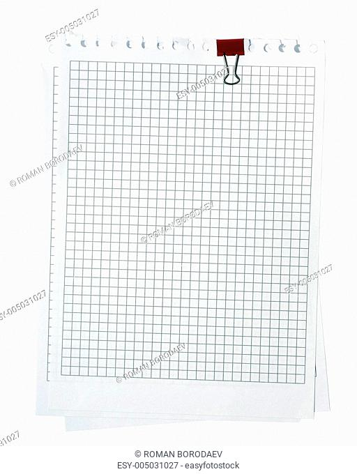 Several plaid notepad pages stacked with red paper-clip. Isolate