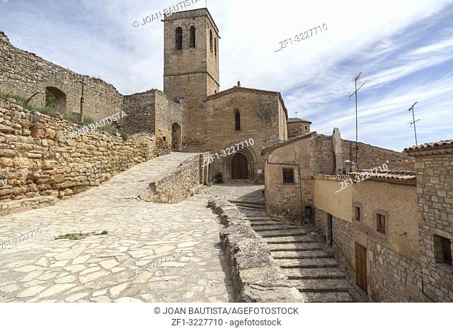 Village street view, ancient buildings and church, medieval village of Guimera, Province Lleida, Catalonia, Spain