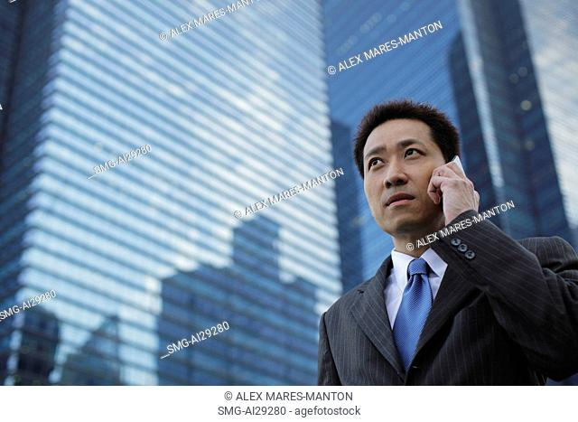 Mature man wearing a suit and talking on the phone