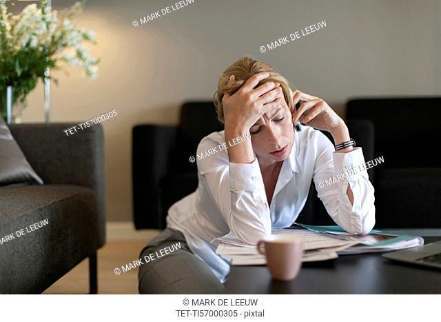 Portrait of sad woman using mobile phone