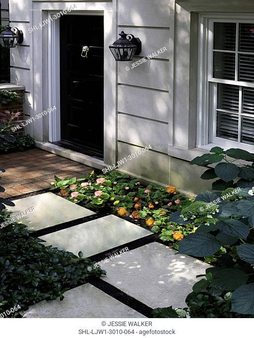 FRONT DOORS: City living, cut limestone, black door, brick walk, stepping stones, begonia and hydrangea