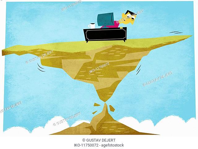 Anxious man working at desk precariously balance on wobbly rock pinnacle