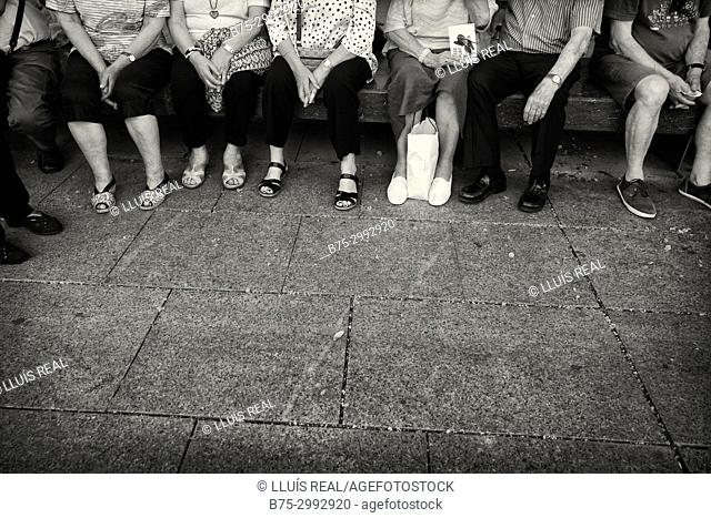 Old people sitting in bench, unrecognizable, Barcelona, Catalonia, Spain