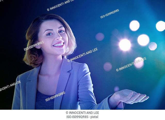 Young woman with lights