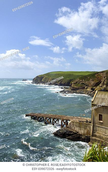Early summer afternoon sunshine after a storm on the old lifeboat station at Lizard Point in the Lizard Peninsula, Cornwall, UK
