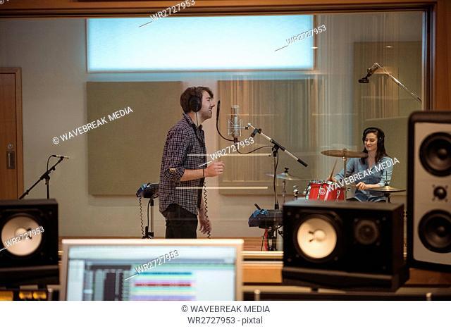 Man singing in recording studio