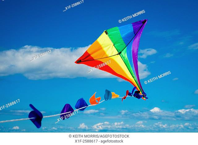 Summer holidays UK: A multi-coloured kite flying in the sky on a warm sunny summer's afternoon