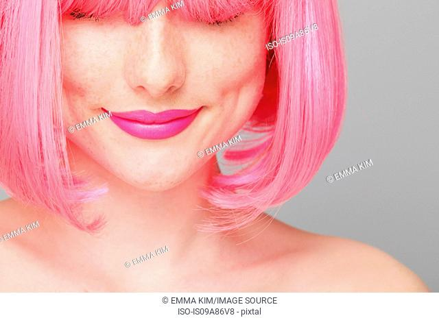 Close up of teenage girl with pink hair