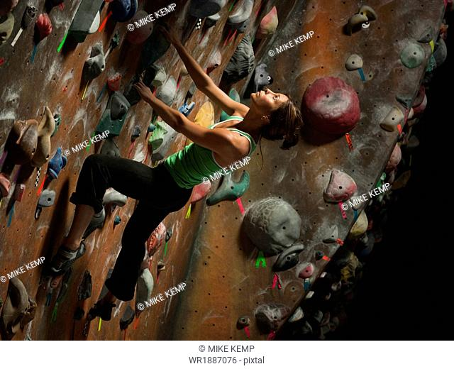 Sandy,Utah,USA,Young woman climbing on wall,elevated view