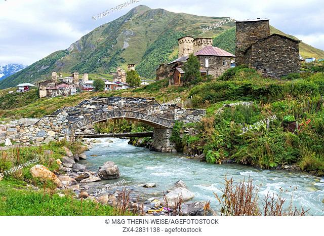 Traditional medieval Svanetian tower houses, Stone bridge over Patara Enguri River, Ushguli village, Svaneti region, Georgia, Caucasus, Middle East, Asia