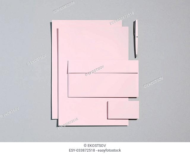 Pink branding mockup on a gray background