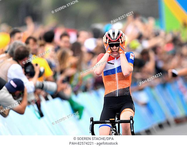 Anna van der Breggen from the Netherlands celebrates as she crosses the finish line to win the Gold medal at the Women's Road Race of the Cycling Road event...