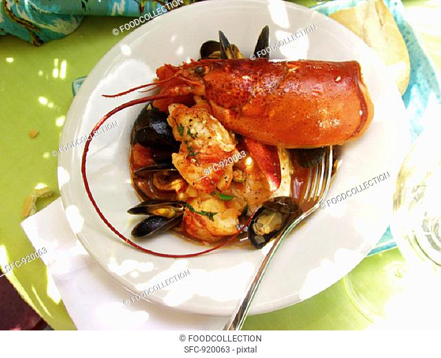 Creole lobster and mussel stew on table in open air