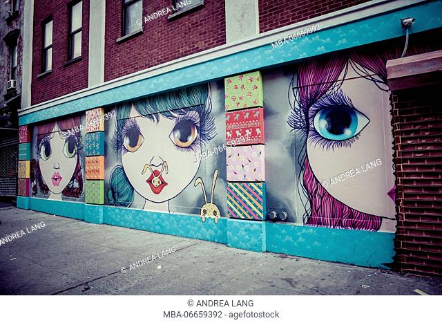 Graffiti and Street Art, big eyes girls, manga style, Manhatten, New York, USA