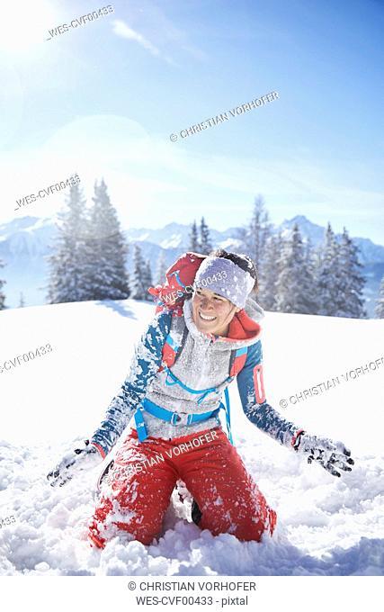 Austria, Tyrol, female hiker having fun in the snow