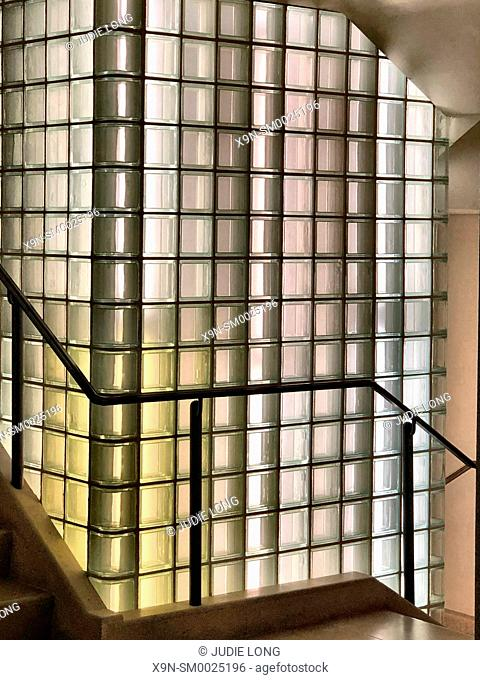 Manhattan, New York City. Close Uo of an Interior Stairway, Lighted Glass Block Column in the Center