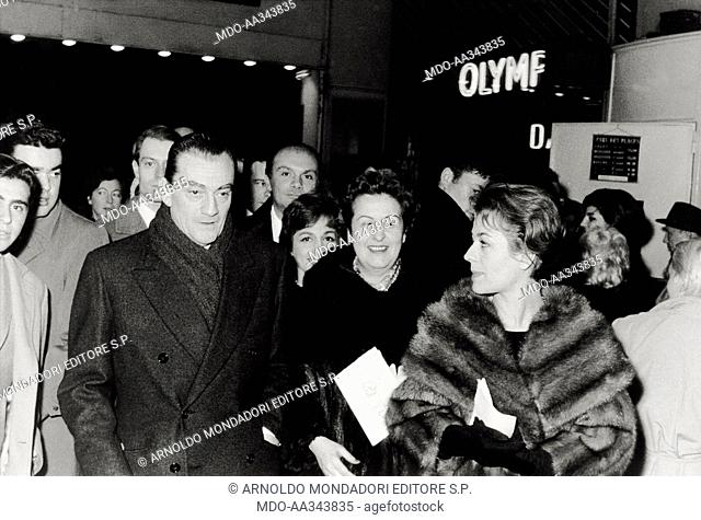 Luchino Visconti and Annie Girardot at the concert of Edith Piaf. Italian director Luchino Visconti and French actress Annie Girardot coming out from the...