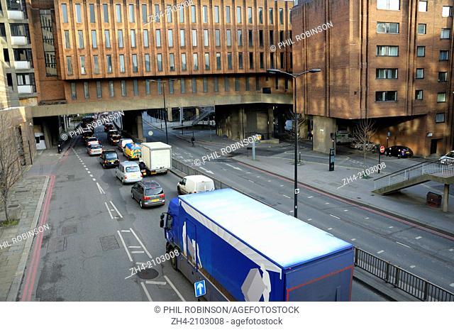 London, England, UK. Traffic in Castle Baynard Street / Upper Thames Street, City of London
