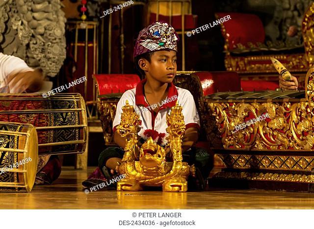 Boy in a gamelan orchestra, Ubud, Bali, Indonesia