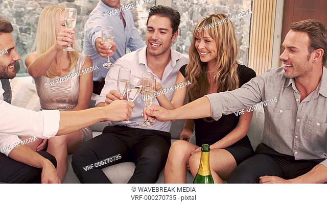 Happy friends toasting with champagne